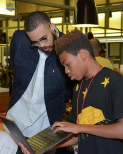 a student shows Javale McGee a coding project