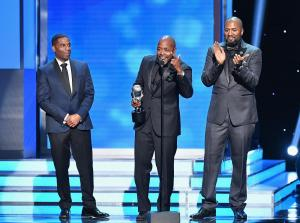 James Lopez, Will Packer, and Malcolm D. Lee accept the Outstanding Motion Picture award
